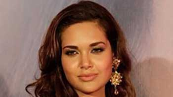 Esha Gupta Shows Her Professionalism- Not to Attend Family Wedding to Meet Work Commitments