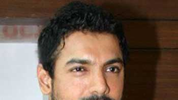 John Abraham to auction clothes for charity