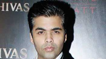 Karan Johar to adopt a child