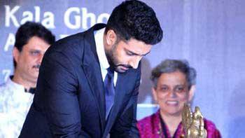 Abhishek Does it All for Daddy Bachchan!