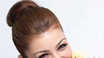 Ayesha Takia poses with a chick for PETA campaign