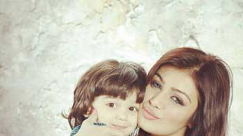 Ayesha Takia poses with her cute son