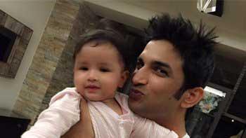 Sushant Singh Rajput cradles MS Dhoni's little daughter Ziva!